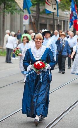 ZURICH - AUGUST 1: Swiss National Day parade on August 1, 2009 in Zurich, Switzerland. Woman in a historical costume. Stock Photo - 10820396