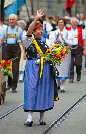 ZURICH - AUGUST 1: Swiss National Day parade on August 1, 2009 in Zurich, Switzerland. Woman in a historical costume. Stock Photo - 10820397