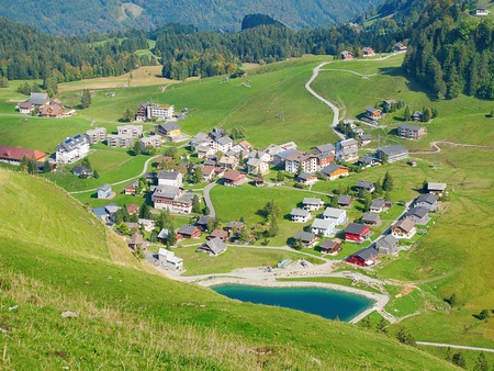 Aerial view of small swiss village in alps photo