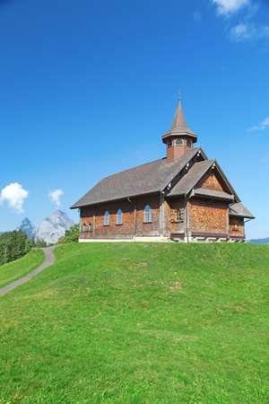 Small wooden church in swiss alps photo
