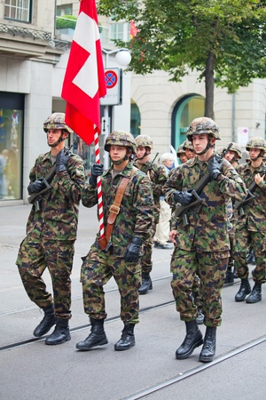 helvetica: ZURICH - AUGUST 1: Infantery division of Swiss army marching in the Swiss National Day parade on August 1, 2009 in Zurich, Switzerland.