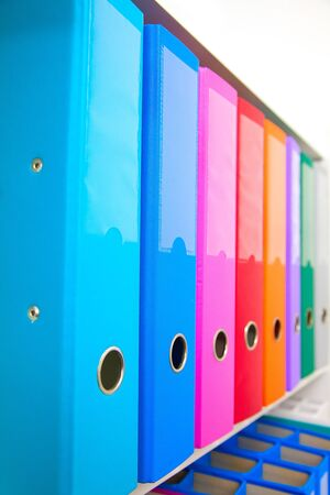Colorful office folders on the bookshelf Stock Photo - 11235642
