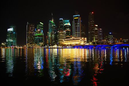 SINGAPORE-AUGUST 05: Singapore skyline at night on August 5, 2010. Singapore is one of major international transport and business hub in south-east asia.