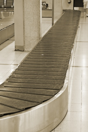 Empty baggage belt in the modern airport photo
