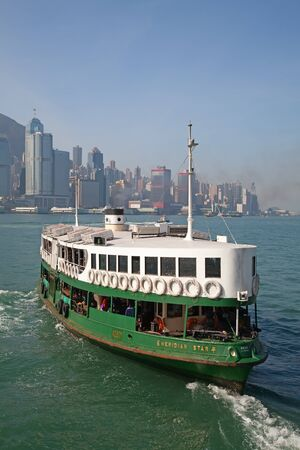 HONG KONG - DECEMBER 3: Ferry Meridian star leaving Kowloon pier on December 3, 2010 in Hong Kong, China. Hong Kong ferry is in operation in Victoria harbor for more than 120 years and it is one main tourist attractions of the city.