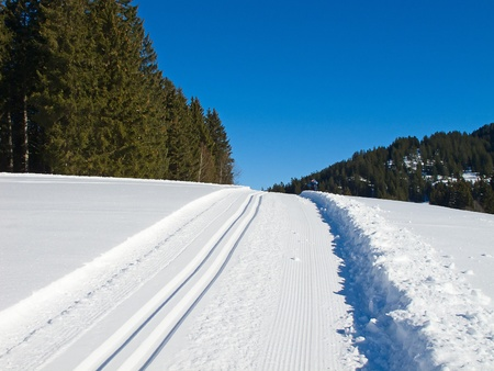 Freshly groomed empty cross-country ski track in swiss Alps