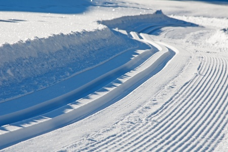 Freshly groomed empty cross-country ski track photo