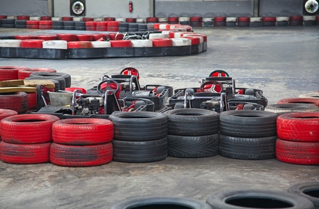 carting: Indoor carting race (carts and safety barriers) Editorial