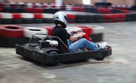 carting: Indoor carting race (cart and safety barriers) Editorial
