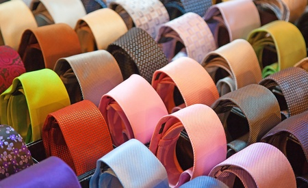 mens: Many colorful ties with different designs on wardrobe