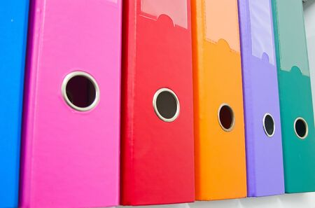 filing system: Colorful office folders on the bookshelf Stock Photo