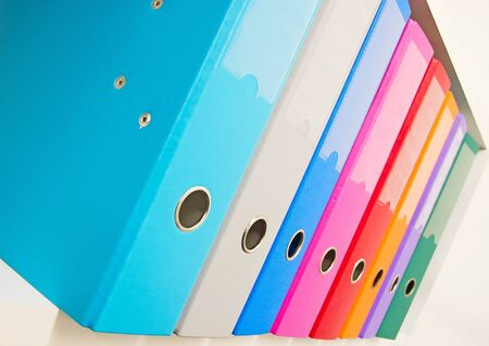 Colorful office binders on the bookshelf Stock Photo - 11717537