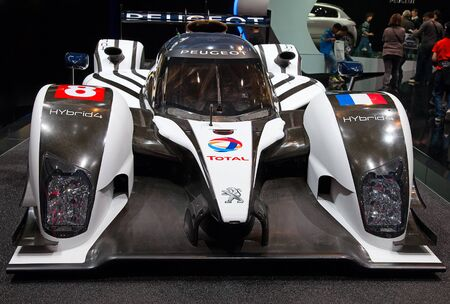 GENEVA - MARCH 8: The Peugeot racing HYbrid4 on display at the 81st International Motor Show Palexpo-Geneva on March 8; 2011  in Geneva, Switzerland.
