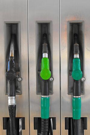 petroleum fuels: Several gasoline pump nozzles at petrol station