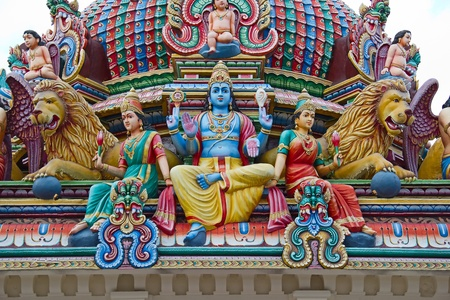 Fragment of decorations of the Hindu temple Sri Mariamman in Singapore photo