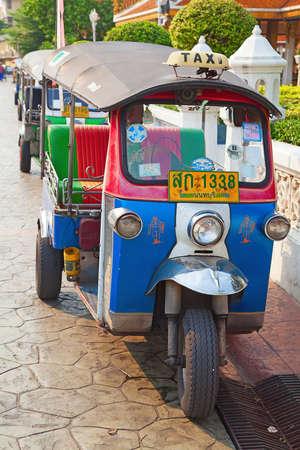 mototaxi: Famous bangkok moto-taxi called tuk-tuk