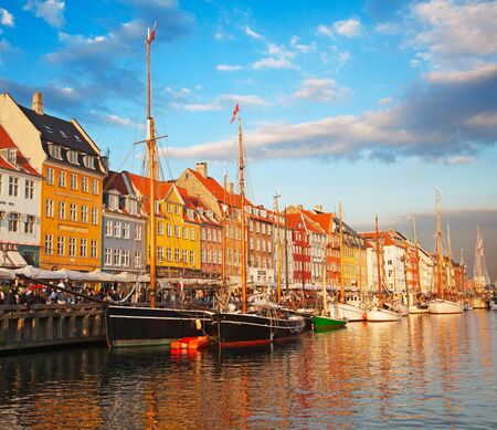 COPENHAGEN, DENMARK - AUGUST 25: unidentified people enjoying sunny weather in open cafees of the famous Nyhavn promenade on August 25, 2010 in Copenhagen, Denmark Stock Photo - 12877861