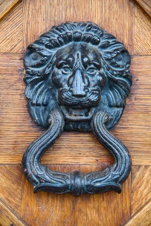 doorknocker: Lion head, brass door knocker