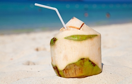 Coconut cocktail on the white sandy beach photo