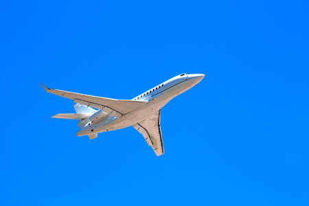 Private jet plane in the blue sky photo