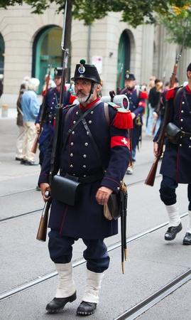ZURICH - AUGUST 1: Swiss National Day parade on August 1, 2009 in Zurich, Switzerland. Men in a historical military uniform of city Zurich. Stock Photo - 13580934
