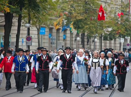 ZURICH - AUGUST 1: Swiss National Day parade on August 1, 2009 in Zurich, Switzerland. Representatives of canton St. Gallen in a historical costume. Stock Photo - 13580940