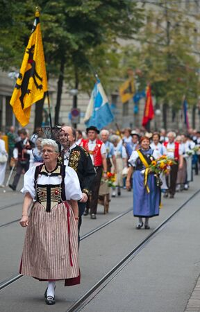 ZURICH - AUGUST 1: Swiss National Day parade on August 1, 2009 in Zurich, Switzerland. Woman in a historical costume. Stock Photo - 13580943