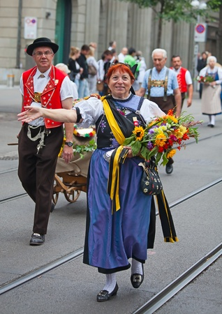 ZURICH - AUGUST 1: Swiss National Day parade on August 1, 2009 in Zurich, Switzerland. Woman in a historical costume. Stock Photo - 13580941