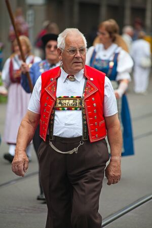 ZURICH - AUGUST 1: Swiss National Day parade on August 1, 2009 in Zurich, Switzerland. Representative of canton Appenzeller in a historical costume. Stock Photo - 13580938