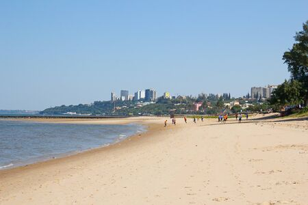 People playing soccer on the beach in Maputo, Mozambique Stock Photo