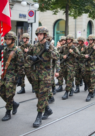 ZURICH - AUGUST 1: Swiss Infantry division taking part in Swiss National Day parade on August 1, 2009 in Zurich, Switzerland.