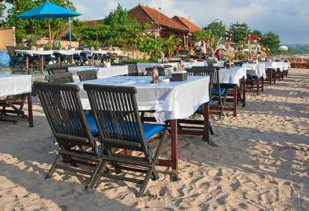 Balinese Jimbaran beach famous for its perfect sea food restaurants Stock Photo