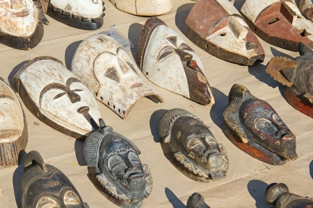 Traditional african masks on the street market photo