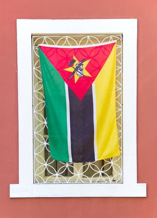 kalashnikov: Flag of Mozambique on window in Maputo