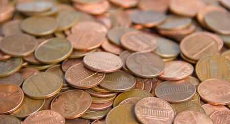 Pile of assorted US coins with shallow depth of field photo