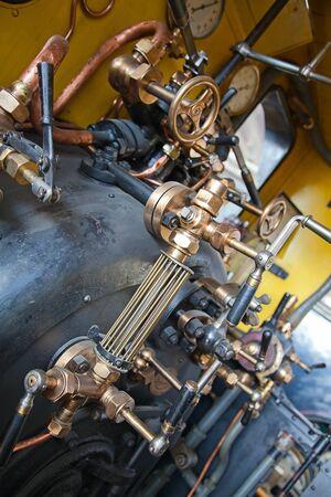 brass valve of old train steam engine photo