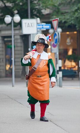ZURICH - AUGUST 1: Swiss National Day parade on August 1, 2009 in Zurich, Switzerland. Representative of professional guilde in a historical costume. Stock Photo - 14143432