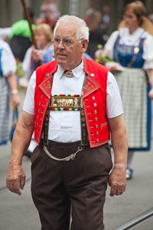 ZURICH - AUGUST 1: Swiss National Day parade on August 1, 2009 in Zurich, Switzerland. Representative of canton Appenzeller in a historical costume. Stock Photo - 14143448