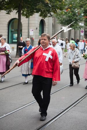 ZURICH - AUGUST 1: Swiss National Day parade on August 1, 2009 in Zurich, Switzerland. Representative of canton Schwyz in a historical costume. Stock Photo - 14143446