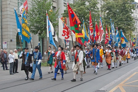 ZURICH - AUGUST 1: Swiss National Day parade on August 1, 2009 in Zurich, Switzerland. Representatives of professional guildes in a historical costumes. Stock Photo - 14143443