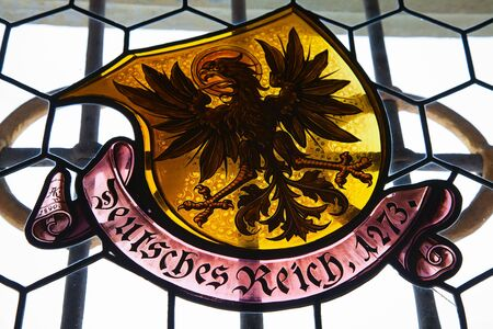 Stained glass window in ancient Kyburg castle near Zurich