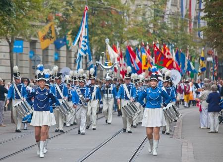 helvetica: ZURICH - AUGUST 1: Swiss National Day parade on August 1, 2011 in Zurich, Switzerland. Zurich city orchestra opening the parade.