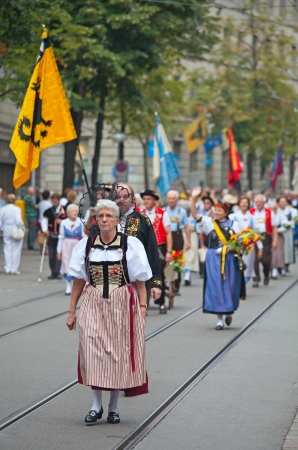 ZURICH - AUGUST 1: Swiss National Day parade on August 1, 2011 in Zurich, Switzerland. Woman in a historical costume. Stock Photo - 14148816