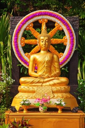 Golden Buddha statue in a small temple photo