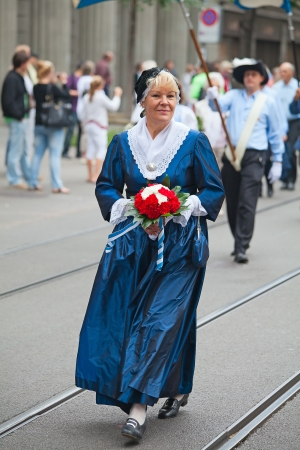 ZURICH - AUGUST 1: Swiss National Day parade on August 1, 2009 in Zurich, Switzerland. Woman in a historical costume. Stock Photo - 14419591