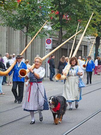 alphorn: ZURICH - AUGUST 1: Swiss National Day parade on August 1, 2009 in Zurich, Switzerland. Traditional alphorn musicians in a historical costumes. Editorial