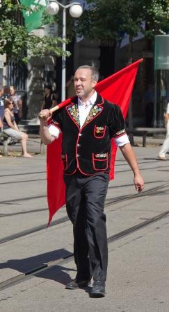appenzeller: ZURICH - AUGUST 1: Swiss National Day parade on August 1, 2009 in Zurich, Switzerland. Representative of canton Appenzeller (Flag thrower) in a historical costume. Editorial