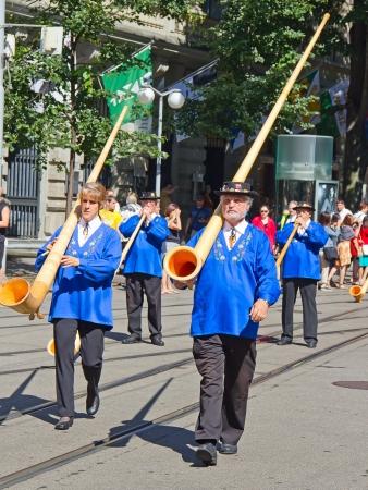 ZURICH - AUGUST 1: Swiss National Day parade on August 1, 2009 in Zurich, Switzerland. Representative of canton Schwyz in a historical costume with traditional instrument Alphorn. Stock Photo - 14685804