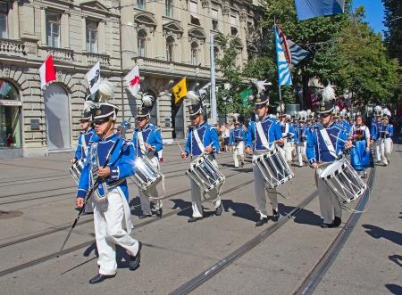 helvetica: ZURICH - AUGUST 1: Zurich city orchestra in national costumes openning the Swiss National Day parade on August 1, 2009 in Zurich, Switzerland. Editorial