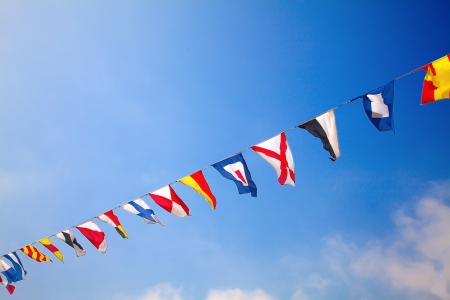nautical vessels: Nautical flags against blue sky Stock Photo